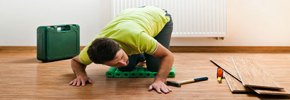 Man Repairing Wood Flooring