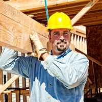 Construction Worker with Lumber
