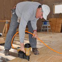Man Nailing Plywood Subfloor