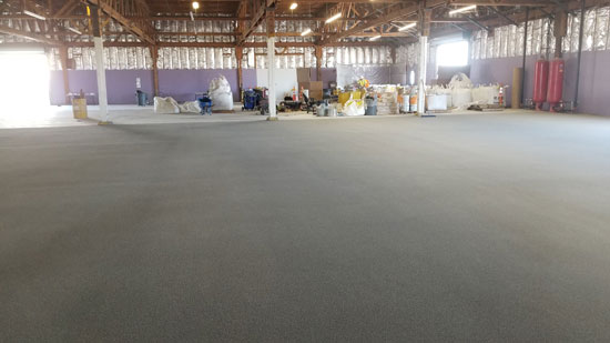 After silica sand has been broadcast