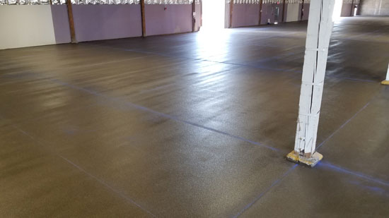 Flooring after sealer and before final saw cutting