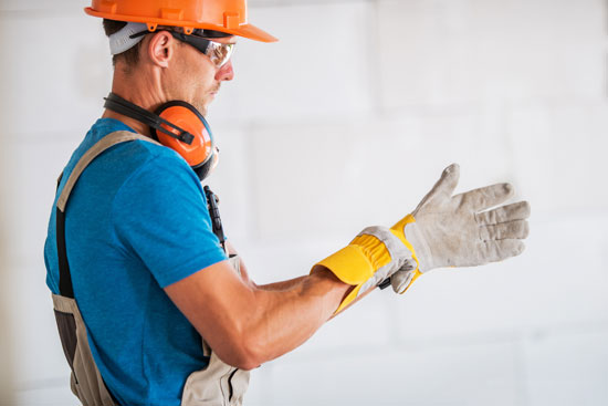 construction worker with gloves and hardhat