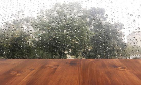 wood next to a rainy window